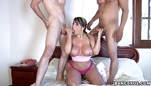 Sandra sucks and jerks two cocks at once