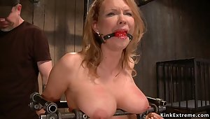Big-Breasted Mommy slave is chained and screwed