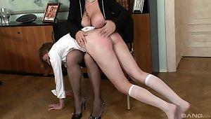 Naughty mistress Madam spanks round ass of usherette girl Lolly Cat